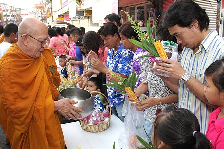 On 13th April Thais will give alms to monks & pour water on hands of elders