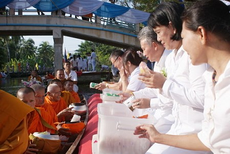 Alms Giving by Boat at Tha Kha Floating Market on Sunday